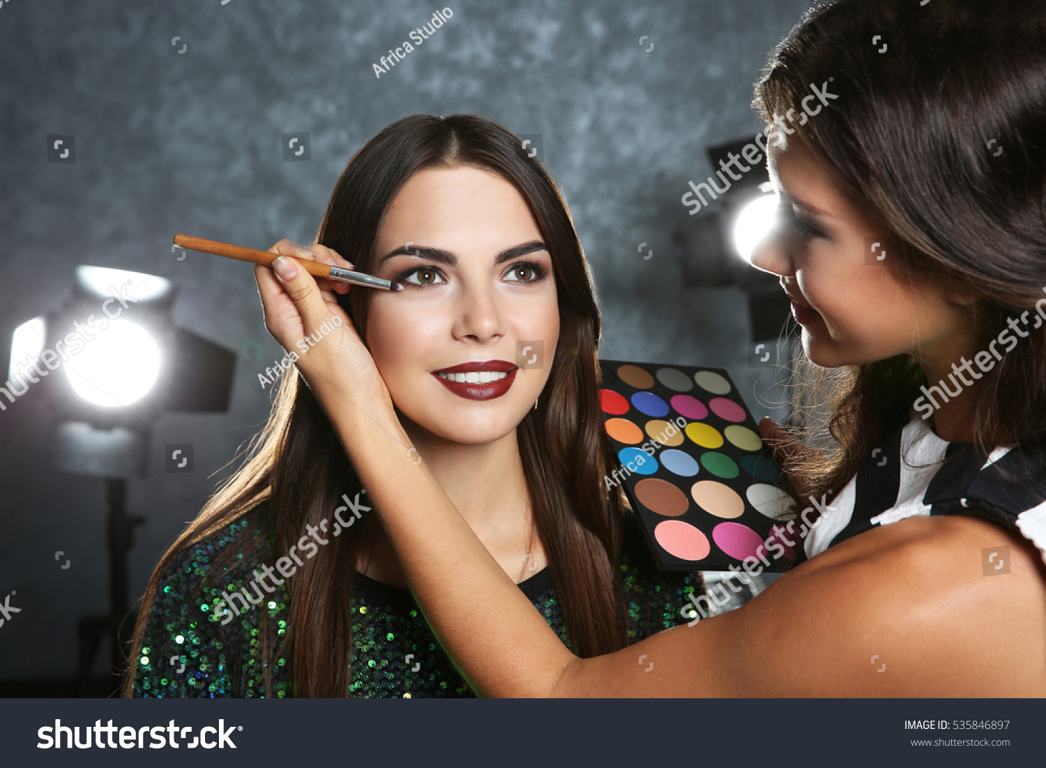 stock-photo-professional-makeup-artist-working-with-beautiful-young-woman-535846897