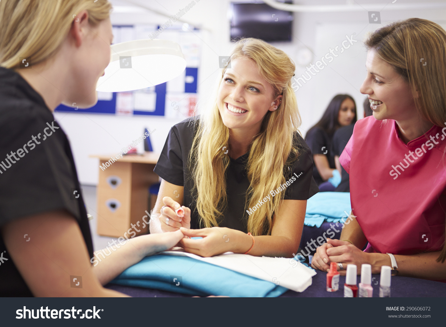 stock-photo-teacher-helping-students-training-to-become-beauticians-290606072